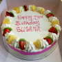 fresh cream cake with fruit around