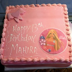 Buttercream barbie cake with bow and picture