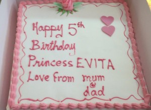 Pretty pink buttercream cake with hearts and roses