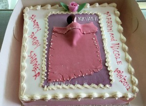 fresh cream baby shower cake with baby tucked in blanket )