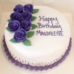 Elegant cake with hand made icing roses